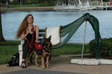 The poet with their service dog outside the Dali Museum in Florida.